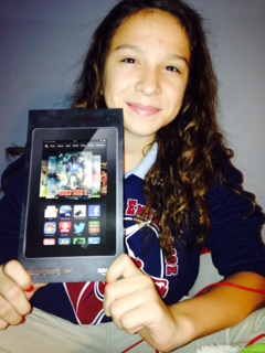 Emily H., winner of the Cool Word Club's Cool Points Contest, shows off her new Kindle Fire HD.